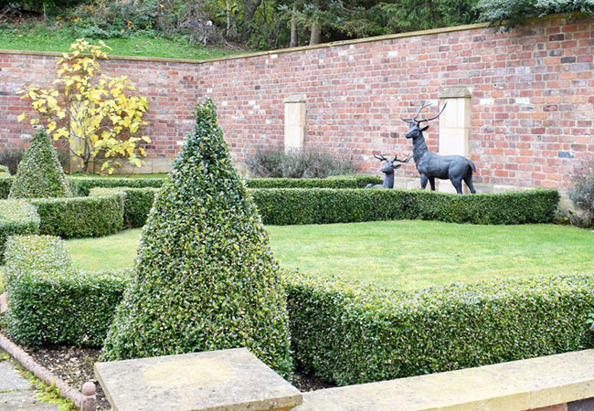 Garden landscape with brick wall and slabs